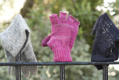 Gloves On A Railing